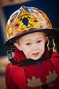 A young boy wears his fathers helmet duing during the international finals of the Firefighter Combat Challenge on November 18, 2011 in Myrtle Beach, South Carolina.