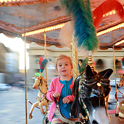 FLORENCE, ITALY - OCTOBER 30: <br /> A young girl riding the antique carousel of the Picci Family operating in the Piazza della Republica in Florence. The carousel dates from the beginning of the 20th century but has been lovingly restored and operates outside the tourist season. Florence, Italy, 30th October 2017. Photo by Tim Clayton/Corbis via Getty Images)