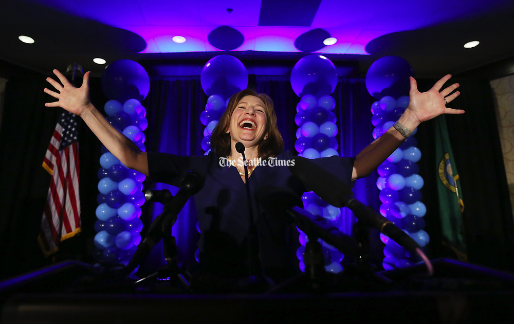 Kim Schrier takes to the stage to speak to supporters Tuesday night in Bellevue. Republican Dino Rossi conceded the 8th Congressional District race to Democrat Kim Schrier on Wednesday. (Ken Lambert / The Seattle Times)