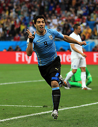Uruguay's Luis Suarez celebrates scoring the opening goal during the Group D match the Estadio do Sao Paulo, Sao Paulo, Brazil.<br /> Picture date: Thursday June 19, 2014. See PA Story SOCCER England. Photo credit should read: Nick Potts/PA Wire. Editorial use only. RESTRICTIONS: No commercial use. No use with any unofficial 3rd party logos. No manipulation of images. No video emulation