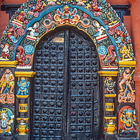 Ornate sculptures and paintings adorn a door at Hanuman Dhoka Palace in the Durbar Square temple complex  in Kathmandu, Nepal.