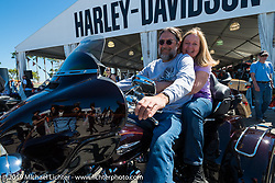 """Don and Rosemary Chill of Clearwater, FL check to see how the new Tri-Glide """"fits"""" at the Harley-Davidson display during Daytona Bike Week. , FL., USA. March 8, 2014.  Photography ©2014 Michael Lichter."""