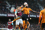 Nikica Jelavic of West Ham United is challenged by Dominic Iorfa of Wolverhampton Wanderers (18) and Danny Batth of Wolverhampton Wanderers (c). The Emirates FA cup, 3rd round match, West Ham Utd v Wolverhampton Wanderers at the Boleyn Ground, Upton Park  in London on Saturday 9th January 2016.<br /> pic by John Patrick Fletcher, Andrew Orchard sports photography.