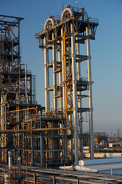 Stock photo of chemical plant piping in the evening