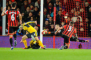 Olivier Giroud (12) of Arsenal celebrates scores the equalising goal beating AFC Bournemouth goalkeeper Artur Boruc to make the score 3-3 during the Premier League match between Bournemouth and Arsenal at the Vitality Stadium, Bournemouth, England on 3 January 2017. Photo by Graham Hunt.