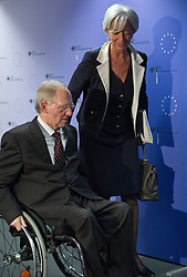 Wolfgang Schaeuble, Germany's finance minister, left, and Christine Lagarde, France's finance minister, depart after a joint press conference following the first meeting of the Van Rompuy task force on economic governance, in Brussels, Belgium, on Friday, May 21, 2010. (Photo © Jock Fistick)