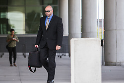 July 26, 2017 - Canada - TORONTO, ON - JULY 26:  TORONTO, ON - JULY 26:  TORONTO, ON - JULY 26:  Durham Police Const. Mark Brown enters the Ontario Coroner's Courts building ahead of his testimony as part of the inquest into the killing of Michael McIsaac. Const. Brown witnessed his colleague Const. Brian Taylor shoot McIsaac in 2013. (Credit Image: © Jesse Winter/The Toronto Star via ZUMA Wire)