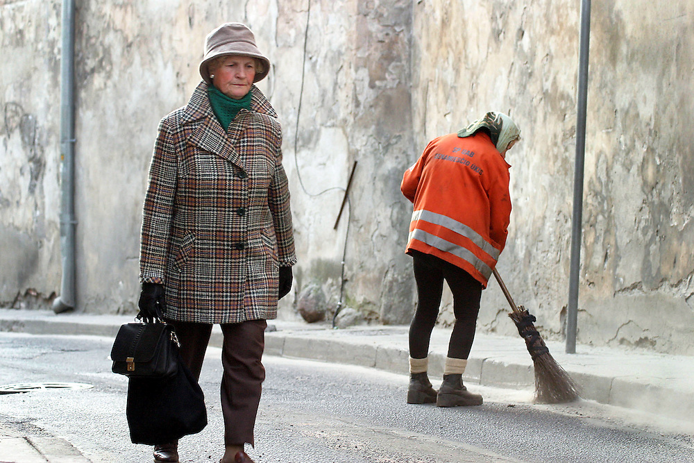 Isganytojo street . Early morning street cleaner Veronika, 66 years of age used to work on a building site as a painter for 40 years. For the last 5 years she sweeps the streets of Vilnius.