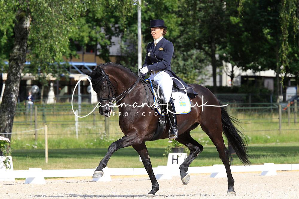 Aspnäs Elin (SWE) - Donna Romma<br /> FEI European Dressage Championship Young Riders - Bern 2012<br /> © Hippo Foto - Leanjo de Koster