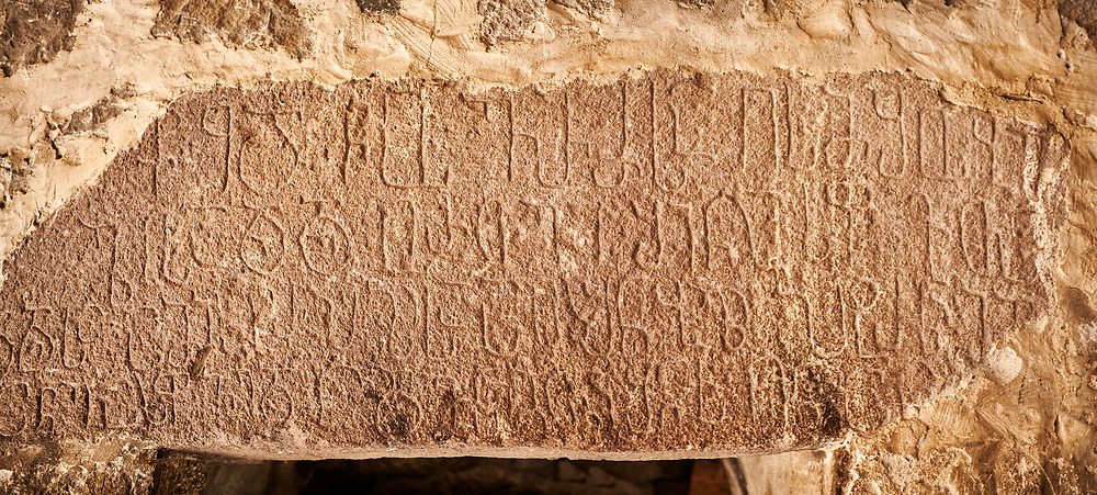 Picture & image of Vardzia medieval cave Church of the Dormition Georgian inscription over door, part of the cave city and monastery of Vardzia, Erusheti Mountain, southern Georgia (country)<br /> <br /> Inhabited from the 5th century BC, the first identifiable phase of building took place at  Vardzia in the reign of Giorgi III (1156-1184) to be continued by his successor, Queen Tamar 1186, when the Church of the Dormition was carved out of the rock and decorated with frescoes .<br /> <br /> Visit our MEDIEVAL PHOTO COLLECTIONS for more   photos  to download or buy as prints https://funkystock.photoshelter.com/gallery-collection/Medieval-Middle-Ages-Historic-Places-Arcaeological-Sites-Pictures-Images-of/C0000B5ZA54_WD0s<br /> <br /> Visit our REPUBLIC of GEORGIA HISTORIC PLACES PHOTO COLLECTIONS for more photos to browse, download or buy as wall art prints https://funkystock.photoshelter.com/gallery-collection/Pictures-Images-of-Georgia-Country-Historic-Landmark-Places-Museum-Antiquities/C0000c1oD9eVkh9c