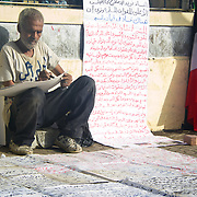 Protester Magdy Iskander writing signs for unity in Tahrir Square. Cairo, Egypt.