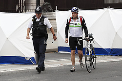 © Licensed to London News Pictures. 14/08/2018. London, UK. Police escort a cyclist as he retreives his bike from behind the cordon - after a car crashed into security barriers outside Parliament. A man had been arrested. A number of people are injured. Photo credit: Peter Macdiarmid/LNP