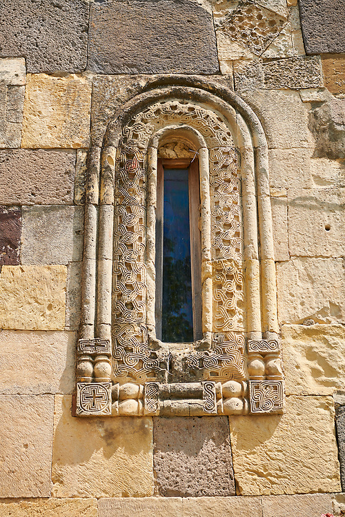 Picture & image of sculpted geometric Georgian style window surround stonework of the Cathedral Of Transfiguration, Medieval Georgian Orthodox, 7-9th century,  Ruisi, Georgia.<br /> <br /> A typical Georgian cruciform & cupola church Ruisi Cathedral Of Transfiguration was built by King Vakhtang Gorgasali in a typical 7th century style. .<br /> <br /> Visit our MEDIEVAL PHOTO COLLECTIONS for more   photos  to download or buy as prints https://funkystock.photoshelter.com/gallery-collection/Medieval-Middle-Ages-Historic-Places-Arcaeological-Sites-Pictures-Images-of/C0000B5ZA54_WD0s<br /> <br /> Visit our REPUBLIC of GEORGIA HISTORIC PLACES PHOTO COLLECTIONS for more photos to browse, download or buy as wall art prints https://funkystock.photoshelter.com/gallery-collection/Pictures-Images-of-Georgia-Country-Historic-Landmark-Places-Museum-Antiquities/C0000c1oD9eVkh9c