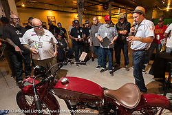 Kiwi Mike in the In Motion invitational bike show build to other builders and judges during the Lone Star Rally. Galveston, TX. USA. Friday November 3, 2017. Photography ©2017 Michael Lichter.