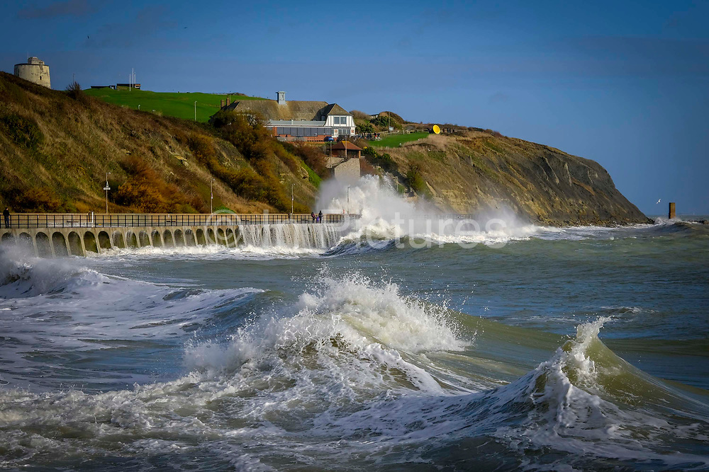 Large waves crash against the sea defence wall on 8th December 2018 at Sunny Sands Beach, Folkestone, Kent, UK.