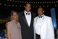 Orlando Magic star basketball player Dwight Howard, center, stands with his parents Sheryl Howard, left, and Dwight Howard, Sr., during the annual Black Ties & Tennies charity gala in Orlando, Florida.