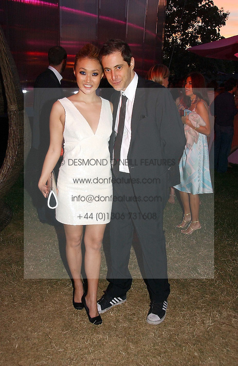 BRUCE WILPON and his wife YUKI OSHIMA-WILPON at the Serpentine Gallery Summer party sponsored by Yves Saint Laurent held at the Serpentine Gallery, Kensington Gardens, London W2 on 11th July 2006.<br /><br />NON EXCLUSIVE - WORLD RIGHTS