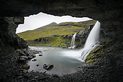Skutafoss waterfall is next to a big cave.