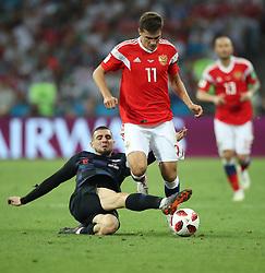 SOCHI, July 7, 2018  Roman Zobnin (C) of Russia vies with Mateo Kovacic (L) of Croatia during the 2018 FIFA World Cup quarter-final match between Russia and Croatia in Sochi, Russia, July 7, 2018. (Credit Image: © Wu Zhuang/Xinhua via ZUMA Wire)