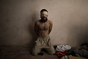 A suspect Islamic State fighter sits in a basement as Iraqi forces continue their advance against Islamic State militants in the Old City of Mosul, Iraq, Monday, July 3, 2017. (AP Photo/Felipe Dana)
