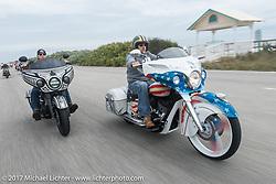Tim Sutherland (L) riding beside Jake Cutler (R) on their custom Indian Chieftains through Tamoka State Park during Daytona Beach Bike Week. FL. USA. Monday March 13, 2017. Photography ©2017 Michael Lichter.