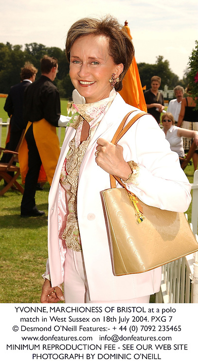 YVONNE, MARCHIONESS OF BRISTOL at a polo match in West Sussex on 18th July 2004.PXG 7
