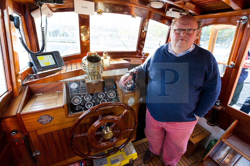 © Licensed to London News Pictures. 16/05/2015. London, UK. Owner and skipper of Dunkirk Little Ship, Hilfranor, Simon Palmer inside his ship cabin. Over 20 Dunkirk Little Ships have gathered in London toay before leaving in the morning to continue their journey to Dunkirk to mark the 75th anniversary of the Dunkirk Evacuations. Photo credit : Vickie Flores/LNP