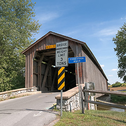 Lancaster, PA - June 9, 2012:  Hunseckers Mill Covered Bridge is unpainted and spans the Conestoga River.