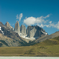 The Towers of Paine loom above Lake Amarga in Torres del Paine National Park, Chile.