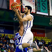 Anadolu Efes's Dogus Balbay (R) during their Turkish Basketball League match Anadolu Efes between Turk Telekom at the Ayhan Sahenk Erdem Arena in Istanbul, Turkey on Sunday, 09 March, 2013. Photo by Aykut AKICI/TURKPIX
