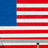 A worker paints an American flag on the south facing side of Big 4 Tire in East Syracuse Thursday, November 5, 2020.