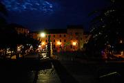 Night-time view of the town square, Kacicev trg, with the statue of friar Andrija Kacic-Miosic. Makarska, Croatia