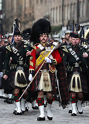 A military pipe band marches on the Royal Mile for a ceremony at the City Chambers, Edinburgh, on the 100th anniversary of the signing of the Armistice which marked the end of the First World War.