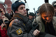 Moscow, Russia, 04/12/2011..Police arrest a woman as Russian opposition supporters demonstrate on Manezhnaya square outside the Kremlin calling for a boycott of the parliamentary elections.