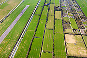 Nederland, Friesland, Smallingerland, 01-05-2013; Drachtstercompagnie, voormalige veenkolonie. De langwerpige stroken zijn het gevolg van het afgraven van het veen voor de productie van turf.<br /> Links de baan van Vliegveld Drachten.<br /> Land in strips in the northern Netherlands caused by peat extraction. Runway of Drachten Airport.<br /> luchtfoto (toeslag op standard tarieven)<br /> aerial photo (additional fee required)<br /> copyright foto/photo Siebe Swart