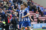 Michael Jacobs of Wigan Athletic (l) celebrates with his teammates after scoring his teams 4th goal. Skybet football league one match , Wigan Athletic v Southend Utd at the DW Stadium in Wigan, Lancs on Saturday 23rd April 2016.<br /> pic by Chris Stading, Andrew Orchard sports photography.