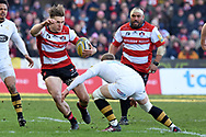 Gloucester fly-half / flanker Jason Woodward tackled on the attack during the Aviva Premiership match between Gloucester Rugby and Wasps at the Kingsholm Stadium, Gloucester, United Kingdom on 24 February 2018. Picture by Alan Franklin.
