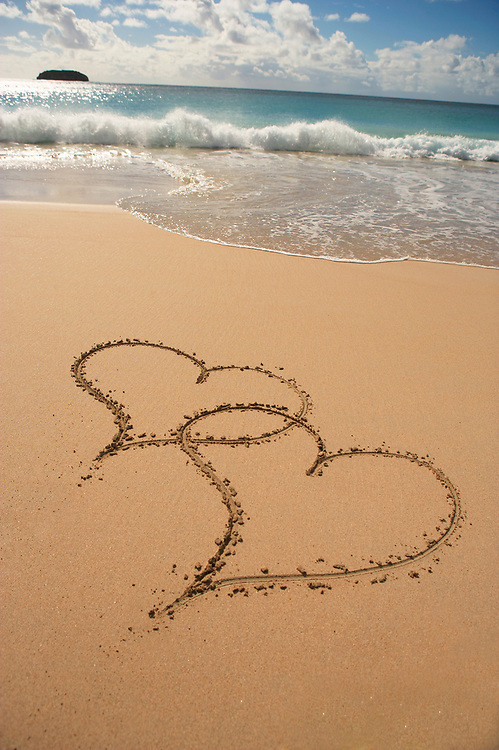 Two hearts in sand at Saline Beach, St. Barthelemy, FWI