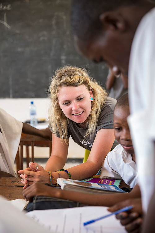 VSO ICS volunteer Jamie Steers discusses ideas with students during the class about writing a CV and applying for work with students at Mingoyo school. Part of the VSO / ICS Elimu Fursa project (Opportunities in Education) Lindi, Lindi region. Tanzania.