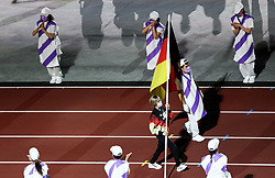 TOKYO, JAPAN - SEPTEMBER 05: Natascha Hiltrop of Team Germany, sports shooter and gold and silver medallist, carries the German flag during the Closing Ceremony of the Tokyo 2020 Paralympic Games at Olympic Stadium on September 5, 2021 in Tokyo, Japan. Photo by Vid Ponikvar / Sportida