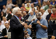 Senator John McCain (R-AZ) answers a question during a health care town hall meeting with fellow Senator Lindsay Graham (R-SC) September 14, 2009 at the Citadel in Charleston, SC.