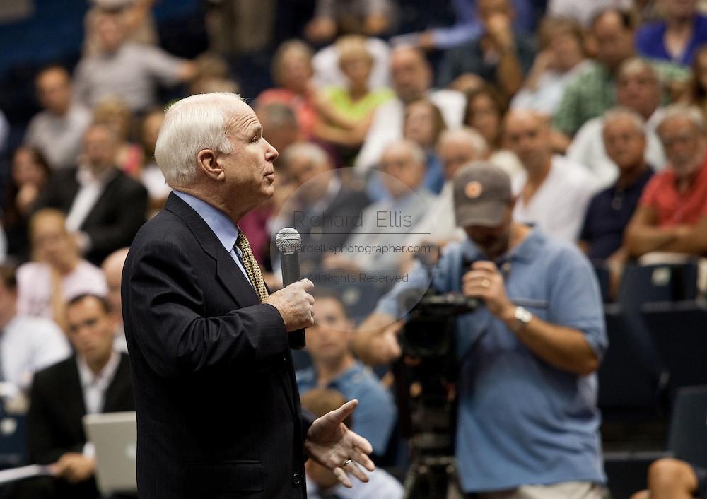 Senator John McCain (R-AZ) answers a question during a health care town hall meeting with fellow Senator Lindsay Graham (R-SC) September 14, 2009 at the Citadel in Charleston, SC.