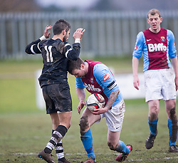 Edusport Academy Yassine Fartassi and Whitehill Welfare Andrew Kidd. Whitehill Welfare 2 v 1 Edusport Academy, South Challenge Cup Quarter Final played 7/3/2015 at Ferguson Park, Carnethie Street, Rosewell.