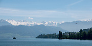 Lucerne, SWITZERLAND<br /> <br /> Looking across the lake from the ferry boat <br /> Day trip on lake Lucerne<br /> <br /> Wednesday  <br />  <br />   25.05.2017<br /> <br /> <br /> © Peter SPURRIER<br /> Panasonic  DMC-LX100  f8  1/2000sec  75mm  5.3MB
