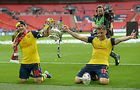 Arsenal's Jack Wilshere and Olivier Giroud celebrate with the FA Cup <br /> <br /> Photographer Ian Cook/CameraSport<br /> <br /> Football - The FA Cup Final - Aston Villa v Arsenal - Saturday 30th May 2015 - Wembley - London<br /> <br /> © CameraSport - 43 Linden Ave. Countesthorpe. Leicester. England. LE8 5PG - Tel: +44 (0) 116 277 4147 - admin@camerasport.com - www.camerasport.com