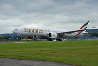 An Emirates Boeing 777-300ER lands at Glasgow airport.