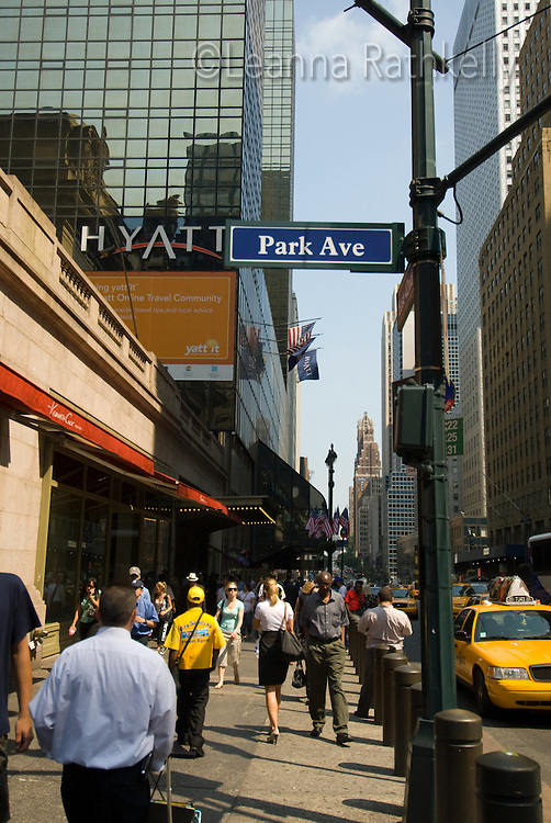 Pedestrians fill the sidewalk at the crossing of Park Avenue, in downtown Manhattan, New York City, NY, USA
