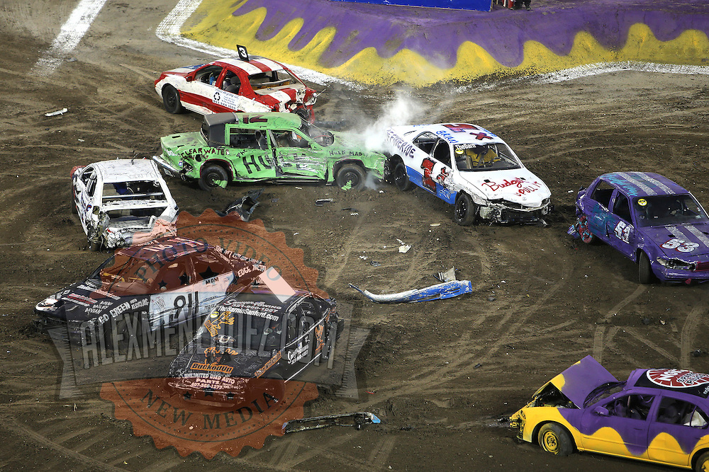 A demolition derby event is seen during the Monster Jam big truck event at the Citrus Bowl in Orlando, Florida on Saturday, January 25, 2014. (AP Photo/Alex Menendez)