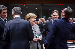 Angela Merkel, Germany's chancellor, center, shares a laugh with David Cameron, the U.K.'s prime minister, far right, as Mari Kiviniemi, Finland's prime minister, second from right, looks on, during the first day of the EU Summit, at the European Council headquarters in Brussels, Belgium on Thursday, Dec. 13, 2012. (Photo © Jock Fistick)