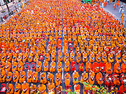 23 NOVEMBER 2014 - BANGKOK, THAILAND: Buddhist monks at a mass alms giving ceremony in Bangkok Sunday. 10,000 Buddhist monks participated in the ceremony on Rajadamri Road in front of Central World shopping mall. The alms giving was to assist Buddhist temples in the insurgency wracked southern provinces of Thailand, where Buddhist monks on their alms rounds have been targeted by Muslim extremists. The ceremony was sponsored by Wat Phra Dhammakaya, the center of the Dhammakaya Movement, a Buddhist sect founded in the 1970s. The temple has become active in Thai politics.    PHOTO BY JACK KURTZ